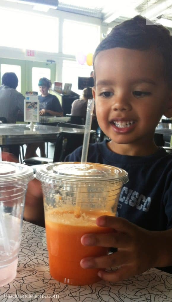 Boy drinking Bunny Juice at Spiral Diner in Dallas, TX