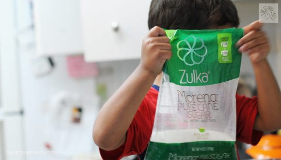 boy holding Zulka sugar used in Spice Cookie Kettle Corn