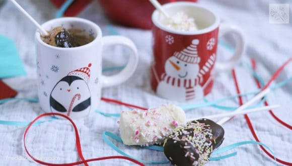 marshmallow swizzle sticks with mugs of hot chocolate