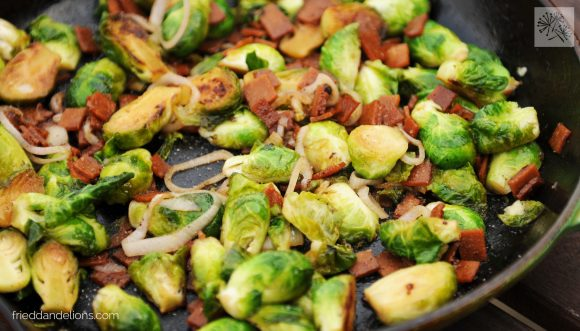 vegan brussels sprouts with bacon in a skillet