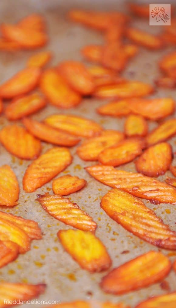 close up of pan of carrots being turned into vegan bacon